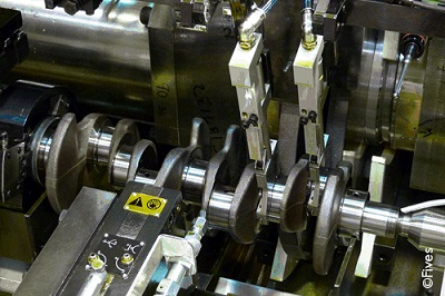 cylindrical-crankshaft-being-grinded copyright light-FIVES Fives in Grinding | Ultra Precision