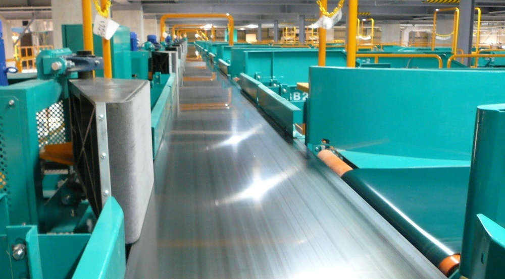 Fives Steel Belt Sorter system is composed of a high-speed diverter with a steel belt conveyor